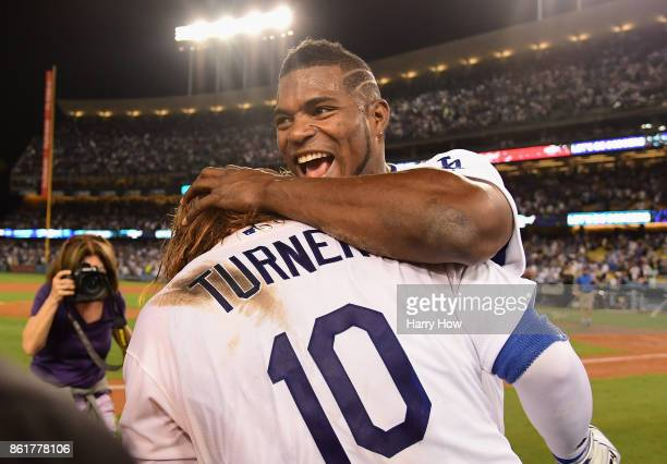 Justin Turner of the Los Angeles Dodgers celebrates with Yasiel Puig after hitting a threerun walkoff home run in the ninth inning to defeat the...