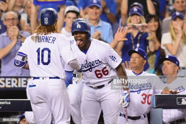 Justin Turner of the Los Angeles Dodgers celebrates with Yasiel Puig after hitting a tworun home run during the sixth inning against the Houston...