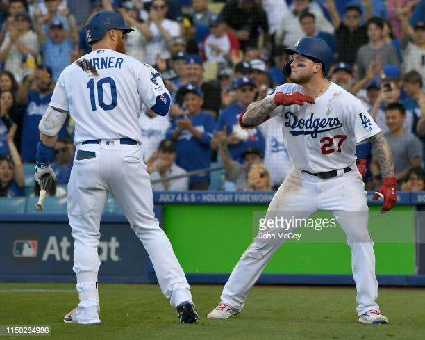 Justin Turner of the Los Angeles Dodgers congratulates Alex Verdugo for a solo home run agaisnt the Colorado Rockies in the fifth inning at Dodger...