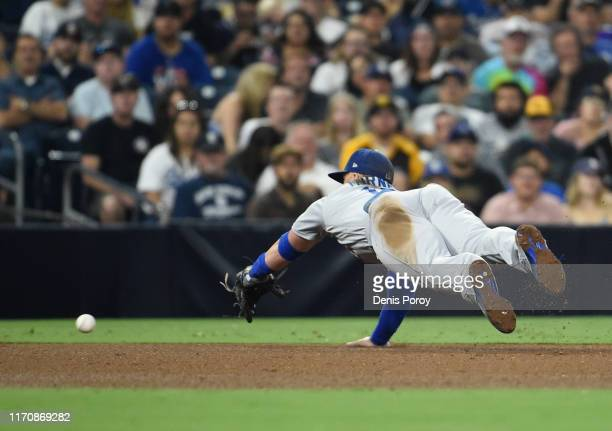Justin Turner of the Los Angeles Dodgers dives but can't make the catch on a double hit by Luis Torrens of the San Diego Padres during the the fifth...