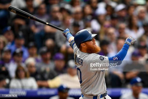 Justin Turner of the Los Angeles Dodgers hits a fifth inning RBI double against the Colorado Rockies during the Colorado Rockies home opener at Coors...
