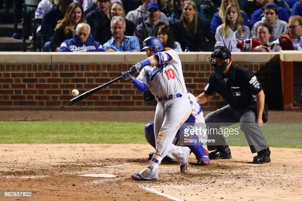 Justin Turner of the Los Angeles Dodgers hits a home run in the eighth inning against the Chicago Cubs during game four of the National League...