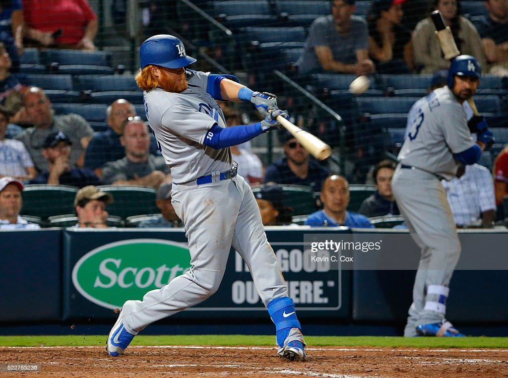 Justin Turner #10 of the Los Angeles Dodgers hits a RBI double for the go-ahead run scored by Chase Utley #26 in the 10th inning against the Atlanta Braves at Turner Field on April 20, 2016 in Atlanta, Georgia.