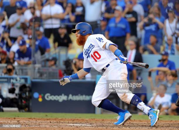 Justin Turner of the Los Angeles Dodgers hits a RBI single in the seventh inning of Game 5 of the NLCS against the Milwaukee Brewers at Dodger...