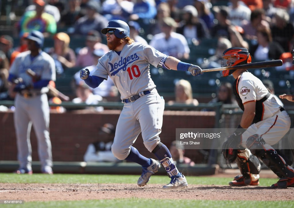 Justin Turner #10 of the Los Angeles Dodgers hits a single that scored Yasmani Grandal #9 in the 10th inning against the San Francisco Giants at AT&T Park on April 27, 2017 in San Francisco, California.