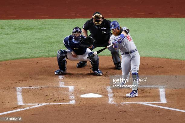 Justin Turner of the Los Angeles Dodgers hits a solo home run against the Tampa Bay Rays during the first inning in Game Three of the 2020 MLB World...