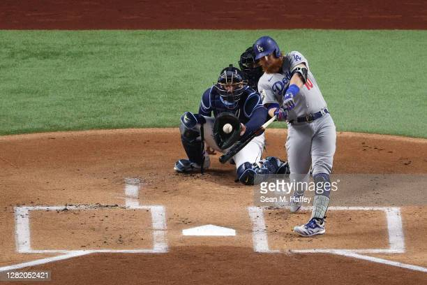 Justin Turner of the Los Angeles Dodgers hits a solo home run against the Tampa Bay Rays during the first inning in Game Four of the 2020 MLB World...