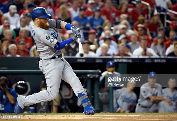 Justin Turner of the Los Angeles Dodgers hits a solo home run in the first inning of game four of the National League Division Series against the...