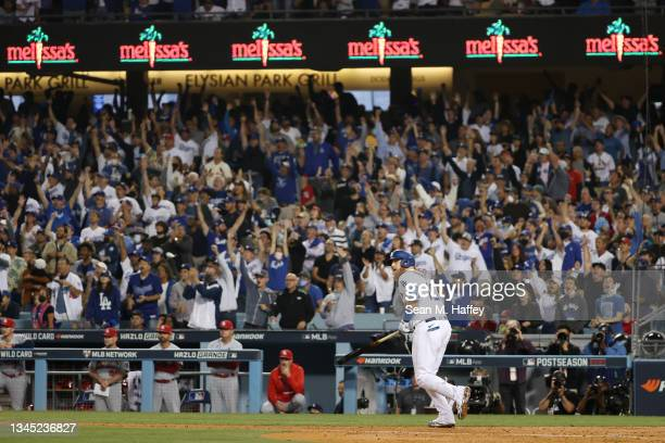 Justin Turner of the Los Angeles Dodgers hits a solo home run in the fourth inning against the St. Louis Cardinals during the National League Wild...