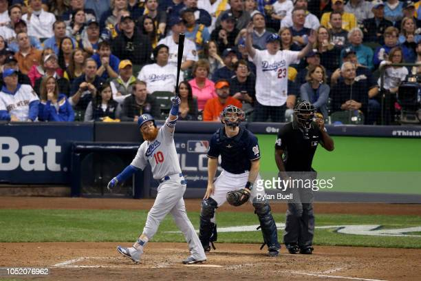 Justin Turner of the Los Angeles Dodgers hits a two run home run against Jeremy Jeffress of the Milwaukee Brewers during the eighth inning in Game...