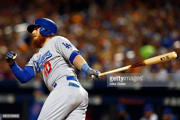Justin Turner of the Los Angeles Dodgers hits a two run RBI to score Howie Kendrick and Adrian Gonzalez against Steven Matz of the New York Mets in...