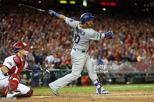 Justin Turner of the Los Angeles Dodgers hits a tworun triple in the seventh inning during Game 5 of NLDS against the Washington Nationals at...