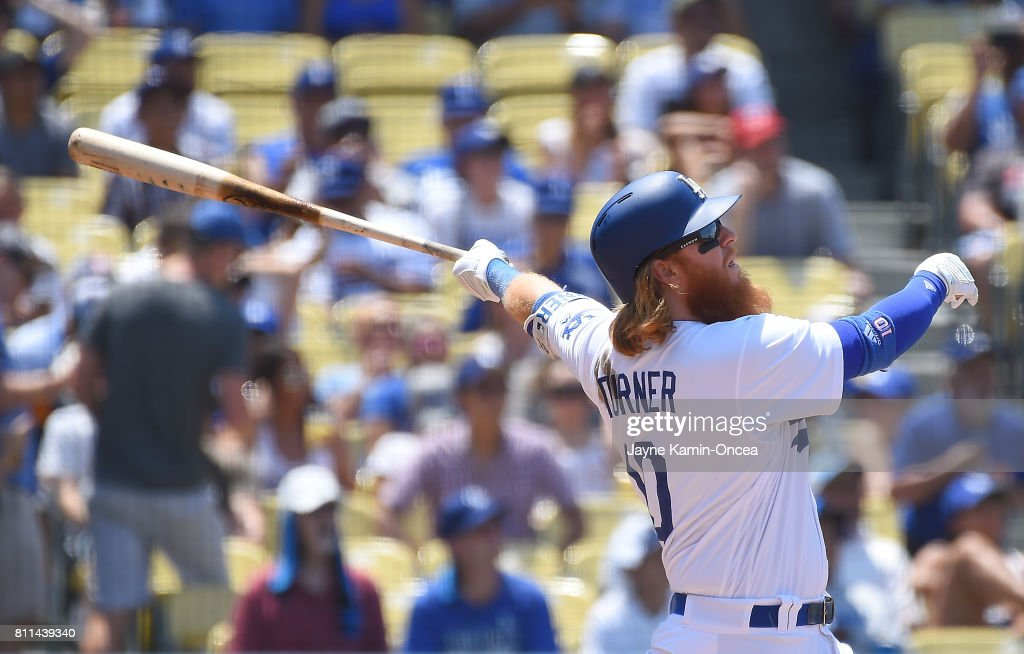 Justin Turner #10 of the Los Angeles Dodgers hits his second home run of the game, a two run shot scoring Logan Forsythe #11, in the third inning against the Kansas City Royals at Dodger Stadium on July 9, 2017 in Los Angeles, California.