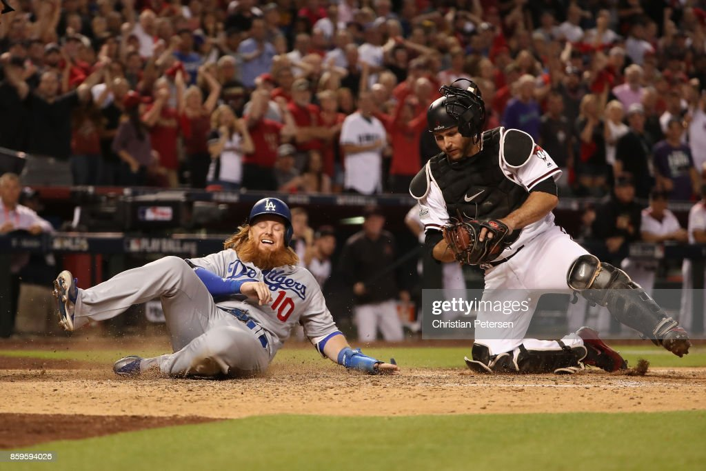 Justin Turner #10 of the Los Angeles Dodgers is tagged out by Chris Iannetta #8 of the Arizona Diamondbacks during the ninth inning of the National League Divisional Series game three at Chase Field on October 9, 2017 in Phoenix, Arizona.