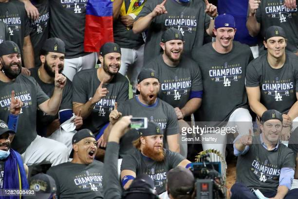 Justin Turner of the Los Angeles Dodgers poses for a photo with his teammates after the teams 3-1 victory against the Tampa Bay Rays in Game Six to...