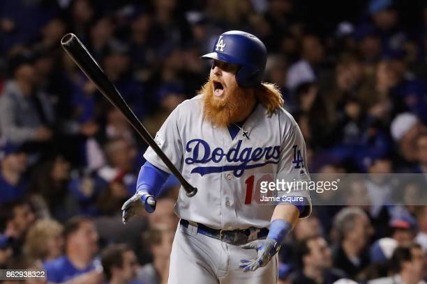 Justin Turner of the Los Angeles Dodgers reacts after hitting a home run in the eighth inning against the Chicago Cubs during game four of the...