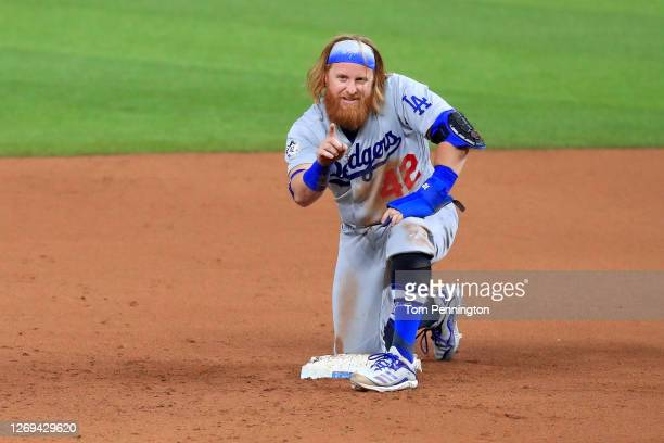 Justin Turner of the Los Angeles Dodgers reacts after stealing second base against the Texas Rangers in the top of the seventh inning at Globe Life...