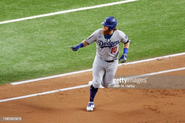 Justin Turner of the Los Angeles Dodgers rounds the bases after hitting a solo home run against the Tampa Bay Rays during the first inning in Game...