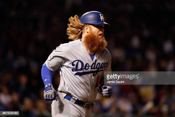 Justin Turner of the Los Angeles Dodgers rounds the bases after hitting a home run in the eighth inning against the Chicago Cubs during game four of...