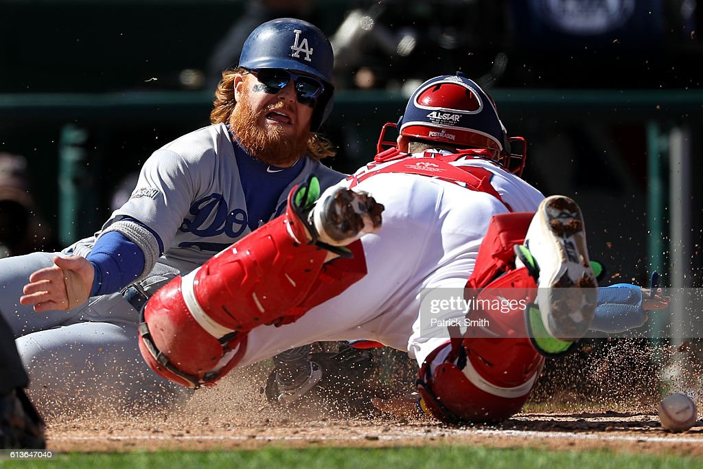 Justin Turner #10 of the Los Angeles Dodgers scores against Jose Lobaton #59 of the Washington Nationals on a single RBI hit by Josh Reddick #11 of the Los Angeles Dodgers (not pictured) in the third inning during game two of the National League Division Series at Nationals Park on October 9, 2016 in Washington, DC.