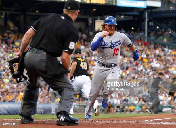 Justin Turner of the Los Angeles Dodgers scores on a RBI single in the third inning against the Pittsburgh Pirates during the game at PNC Park July...