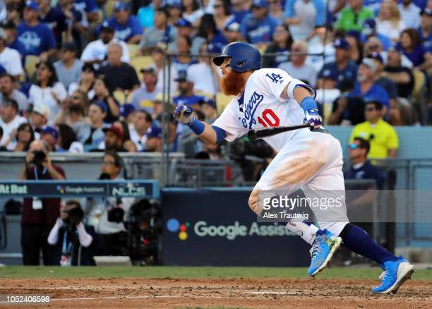 Justin Turner of the Los Angeles Dodgers singles in the sixth inning of Game 5 of the NLCS against the Milwaukee Brewers at Dodger Stadium on...