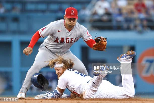 Justin Turner of the Los Angeles Dodgers slides safely into second base against Jose Iglesias of the Los Angeles Angels during the first inning at...