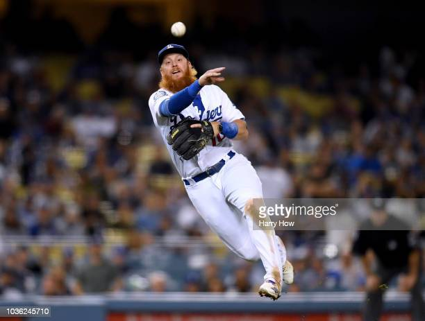 Justin Turner of the Los Angeles Dodgers throws out Ian Desmond of the Colorado Rockies during the ninth inning at Dodger Stadium on September 19...