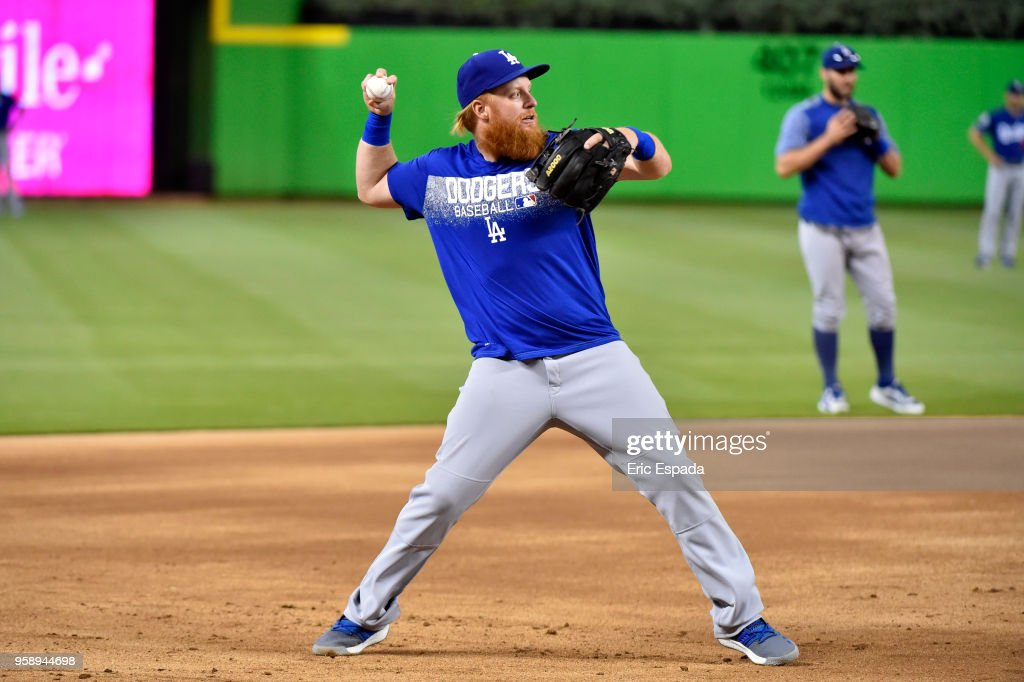 Justin Turner #10 of the Los Angeles Dodgers throws to first base during batting practice before the start of the game against the Miami Marlins at Marlins Park on May 15, 2018 in Miami, Florida.