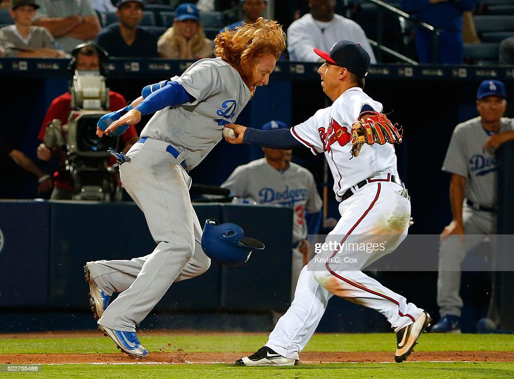 Justin Turner #10 of the Los Angeles Dodgers was tagged out in a rundown by Daniel Castro #14 of the Atlanta Braves down the third base line in the 10th inning at Turner Field on April 20, 2016 in Atlanta, Georgia.