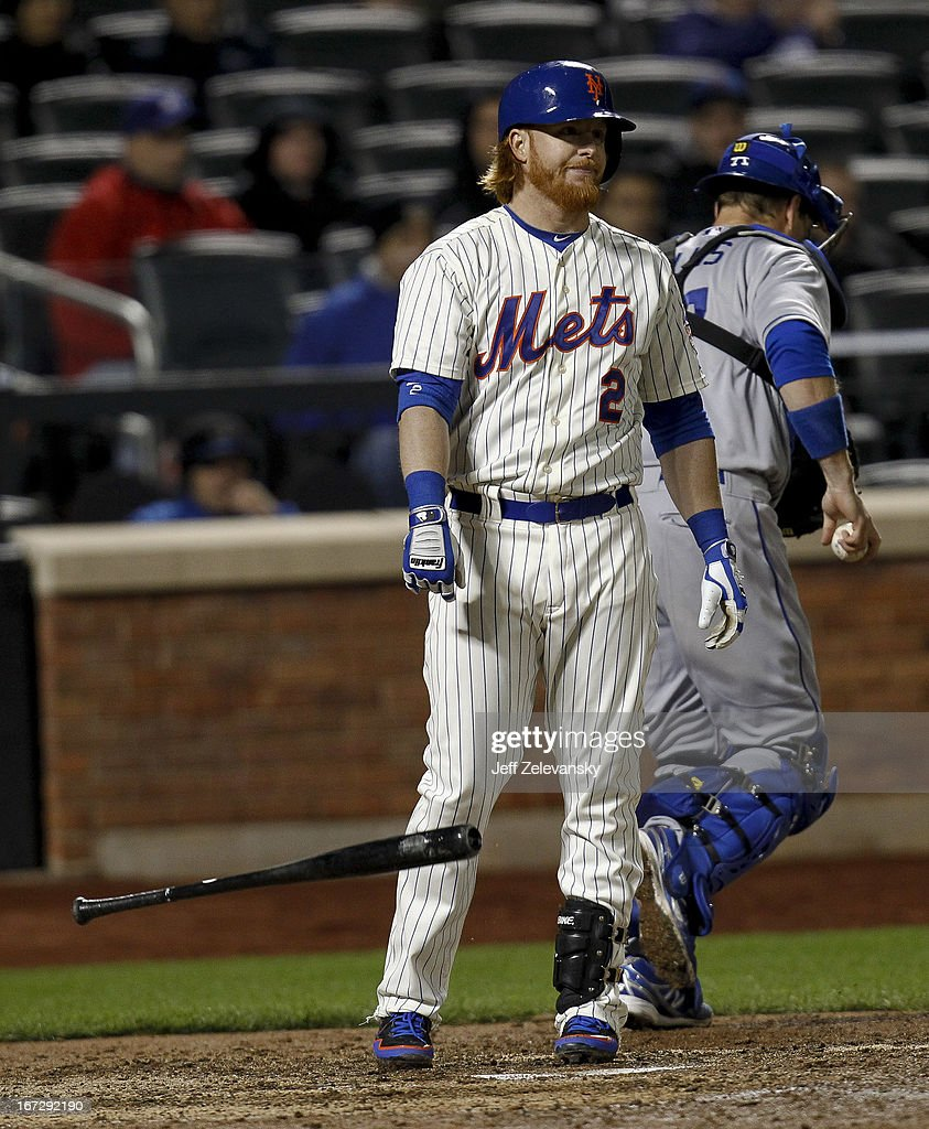Justin Turner #2 of the New York Mets drops the bat after striking out in the sixth inning against the Los Angeles Dodgers at Citi Field in the Flushing neighborhood of the Queens borough of New York City.