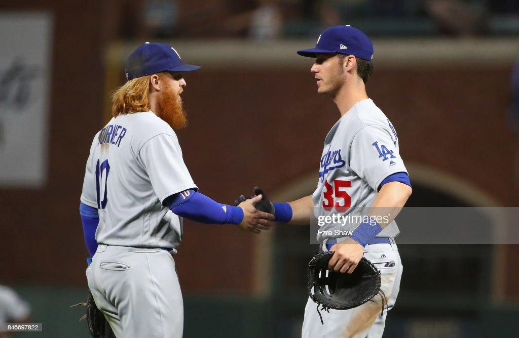 Justin Turner #10 shakes hands with Cody Bellinger #35 of the Los Angeles Dodgers after they beat the San Francisco Giants at AT&T Park on September 13, 2017 in San Francisco, California.