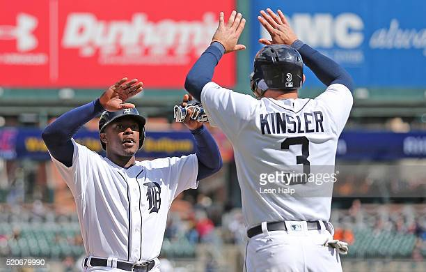 Justin Upton and Ian Kinsler of the Detroit Tigers celebrate after scoring on the double by Victor Martinez during the sixth inning of the...