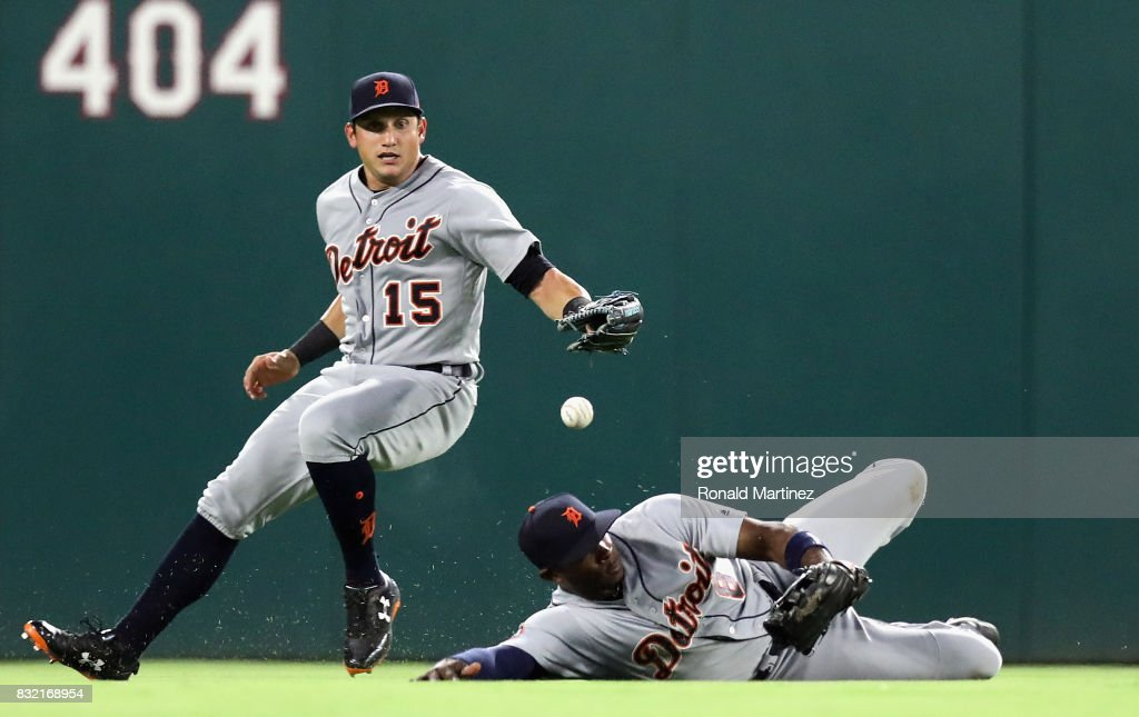 Justin Upton #8 and Mikie Mahtook #15 of the Detroit Tigers reach for a rbi single by Nomar Mazara #30 of the Texas Rangers in the fourth inning at Globe Life Park in Arlington on August 15, 2017 in Arlington, Texas.
