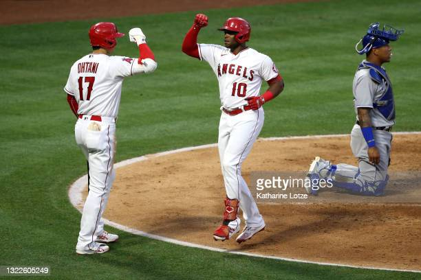 Justin Upton and Shohei Ohtani of the Los Angeles Angels celebrate after Upton's home run in the fifth inning against the Kansas City Royals at Angel...