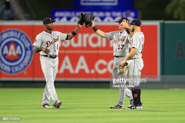 Justin Upton Andrew Romine and Tyler Collins of the Detroit Tigers celebrate defeating the Los Angeles Angels of Anaheim 71 in a game at Angel...