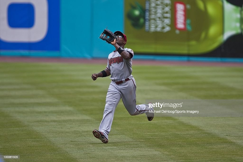 Justin Upton #10 of the Arizona Diamondbacks gets ready to make a catch during a MLB game against the Florida Marlins in Sun Life Stadium on May 18, 2010 in Miami, Florida.