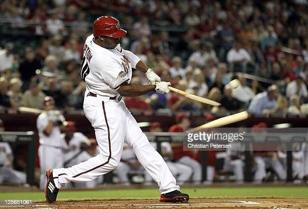 Justin Upton of the Arizona Diamondbacks hits a broken bat single against the Pittsburgh Pirates during the first inning of the Major League Baseball...