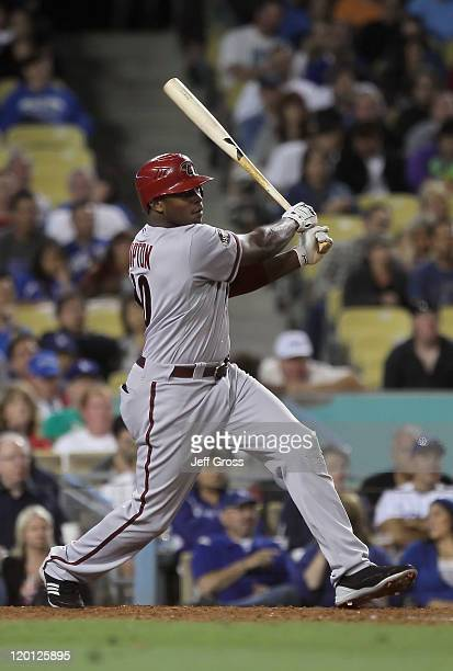 Justin Upton of the Arizona Diamondbacks hits a threeRBI double against the Los Angeles Dodgers in the sixth inning at Dodger Stadium on July 30 2011...