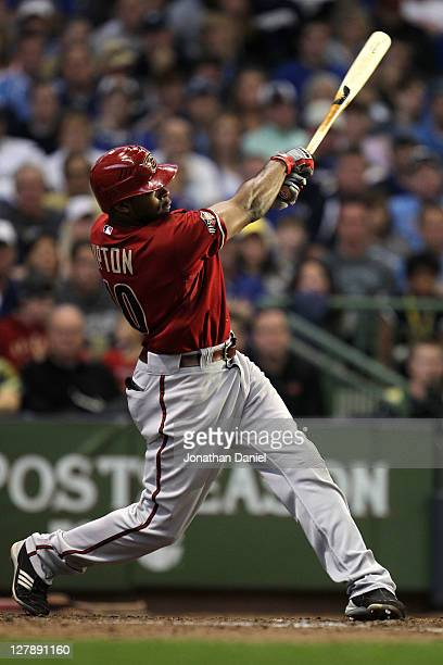 Justin Upton of the Arizona Diamondbacks hits a tworun home run against the Milwaukee Brewers in the fifth inning of Game Two of the National League...