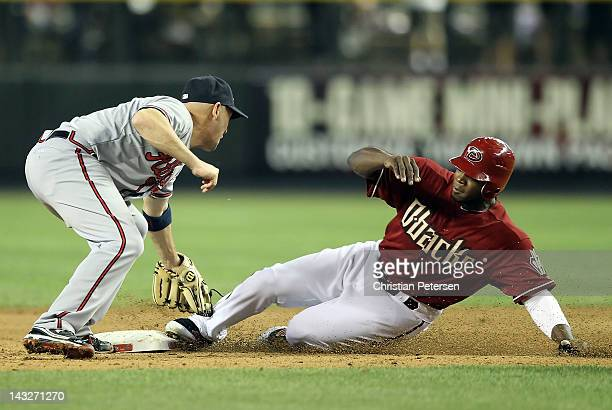 Justin Upton of the Arizona Diamondbacks is tagged out by infielder Jack Wilson of the Atlanta Braves as he attempts to steal second base during the...
