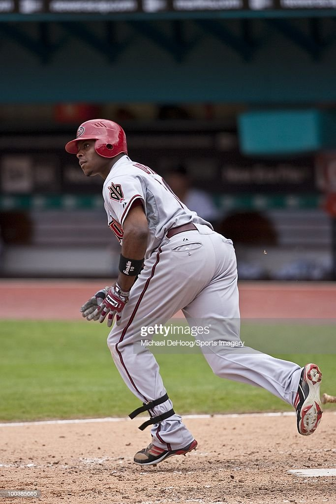 Justin Upton #10 of the Arizona Diamondbacks runs to first base during a MLB game against the Florida Marlins in Sun Life Stadium on May 18, 2010 in Miami, Florida.