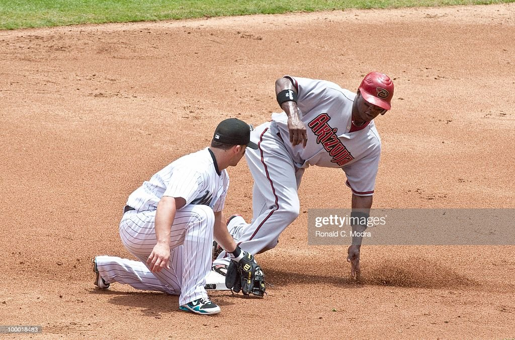 Justin Upton #10 of the Arizona Diamondbacks steals second base as Brian Barden #30 of the Florida Marlins tags him late during a MLB game in Sun Life Stadium on May 18, 2010 in Miami, Florida.
