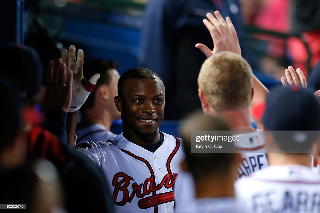 Justin Upton #8 of the Atlanta Braves celebrates hitting a two-run homer in the eighth inning against the Milwaukee Brewers that also scored Jason Heyward #22 at Turner Field on May 19, 2014 in Atlanta, Georgia.