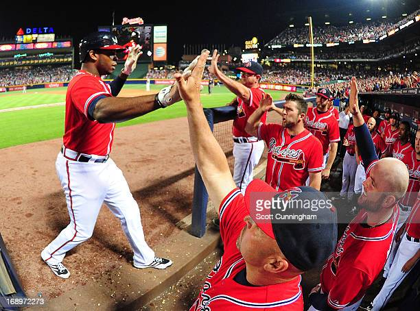 Justin Upton of the Atlanta Braves is congratulated by teammates after hitting a sixthinning grand slam against the Los Angeles Dodgers at Turner...