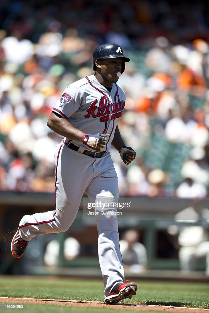 Justin Upton of the Atlanta Braves jobs to first base after