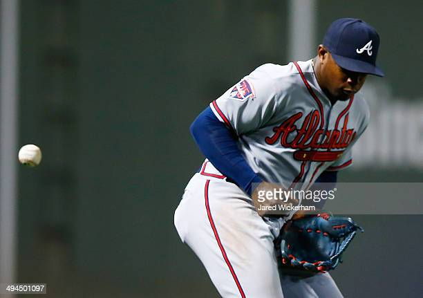 Justin Upton of the Atlanta Braves misses a fly ball in the 8th inning against the Boston Red Sox during the game at Fenway Park on May 29 2014 in...