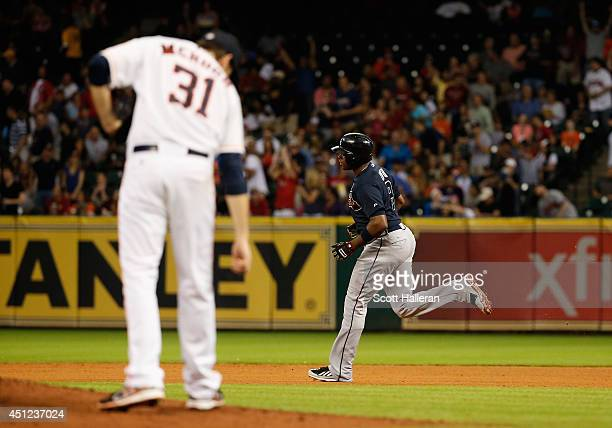 Justin Upton of the Atlanta Braves rounds the bases after his tworun home run in the seventh inning off Collin McHugh of the Houston Astros during...