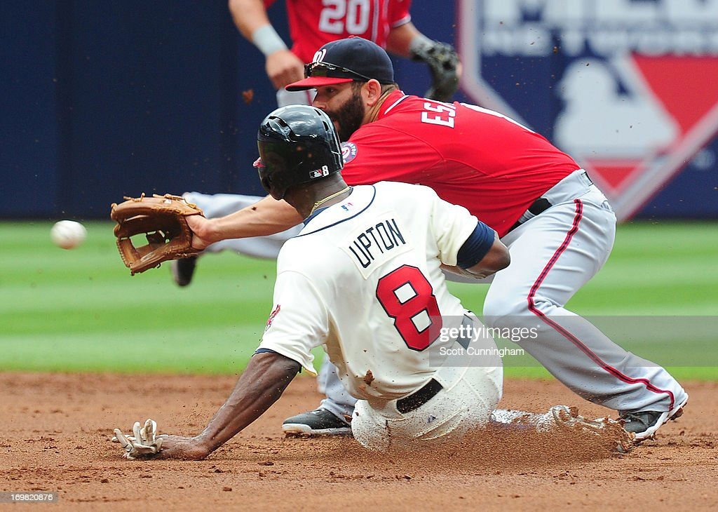 Justin Upton #8 of the Atlanta Braves steals second base against Danny Espinosa #8 of the Washington Nationals at Turner Field on June 2, 2013 in Atlanta, Georgia.