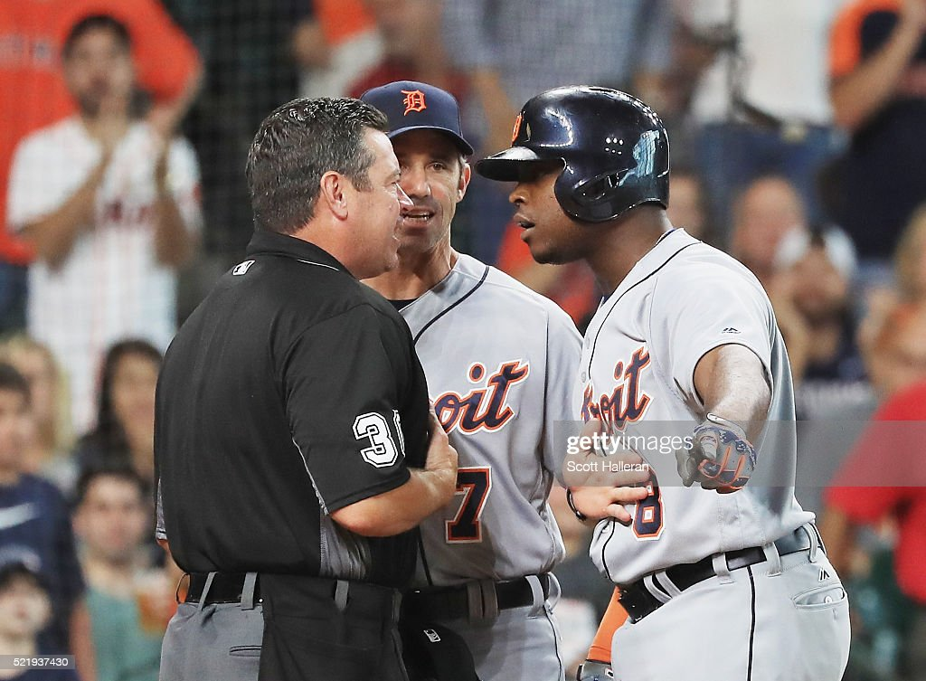 Justin Upton #8 of the Detroit Tigers argues with umpire Rob Drake after being called out on strikes as manager Brad Ausmus looks on during the seventh inning of their game against the Houston Astros at Minute Maid Park on April 17, 2016 in Houston, Texas.